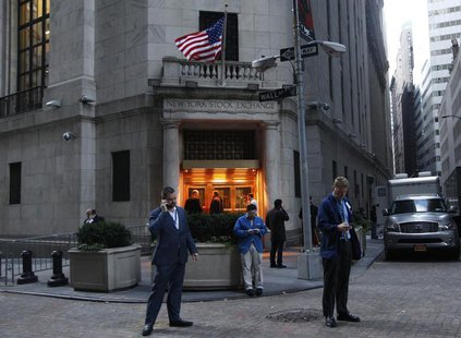 Traders stand outside the New York Stock Exchange prior to the opening bell October 31, 2012. REUTERS/Brendan McDermid