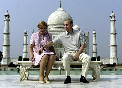 Russian President Vladimir Putin and his wife Lyudmila sit in front of the Taj Mahal while touring the city of Agra in this October 4, 2000