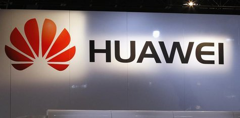 The logo for Chinese phone maker Huawei hangs above their booth on the first day of the Consumer Electronics Show (CES) in Las Vegas January