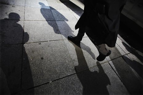 Shadows are seen as a man walks down Bay Street in the financial district in Toronto, March 11, 2009. REUTERS/Mark Blinch