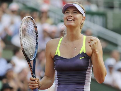 Maria Sharapova of Russia celebrates defeating Victoria Azarenka of Belarus in their women's singles semi-final match during the French Open