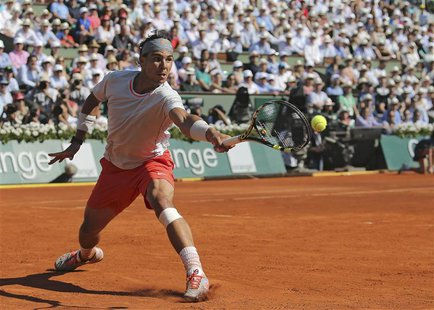 Rafael Nadal of Spain hits a return to Novak Djokovic of Serbia during their men's singles semi-final match at the French Open tennis tourna
