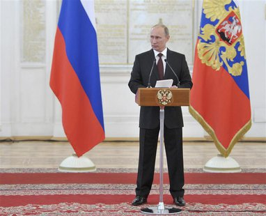 Russia's President Vladimir Putin delivers a speech during a meeting with Russian military officers at the Kremlin in Moscow, June 7, 2013.