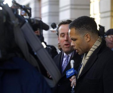 Former U.S. Rep. Jesse Jackson, Jr. (D-IL) (R) departs the U.S. District Federal Courthouse in Washington February 20, 2013. REUTERS/Gary Ca