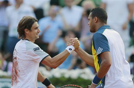 David Ferrer (L) of Spain shakes hands with Jo-Wilfried Tsonga of France after winning their men's singles semi-final match during the Frenc