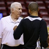 San Antonio Spurs Head Coach Gregg Popovich (L) speaks to guard Tony Parker during a team practice ahead of Game 2 of the NBA Finals basketb