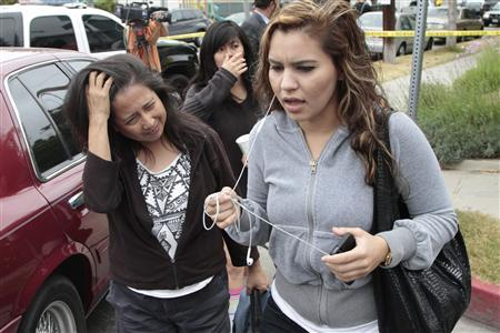 Women leave Santa Monica College following a shooting on campus in Santa Monica, California June 7, 2013.  REUTERS/Jonathan Alcorn