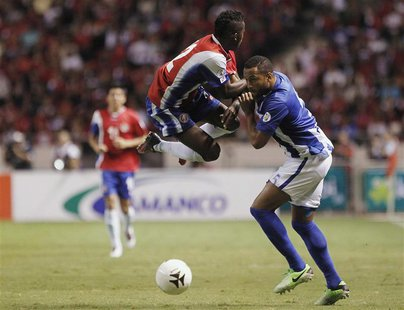 Costa Rica's Joel Campbell (L) fights for the ball with Honduras' Victor Bernardez during their 2014 World Cup qualifying soccer match at th