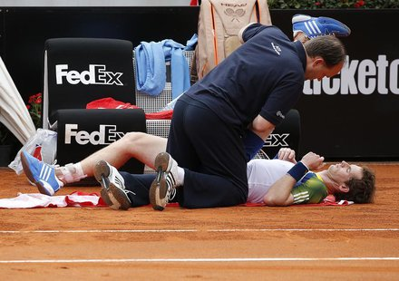Andy Murray of Britain receives medical care during his match against Marcel Granollers of Spain at the Rome Masters tennis tournament May 1