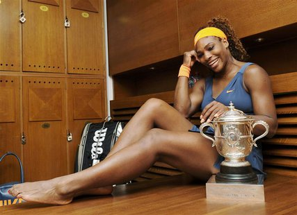 Serena Williams of the U.S. poses with her trophy after defeating Maria Sharapova of Russia in their women's singles final match to win the