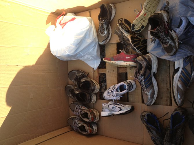 Racers donate their shoes after finishing the 5k race. 2013 Kalamazoo Mud Run