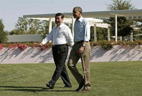 U.S. President Barack Obama and Chinese President Xi Jinping (L) walk the grounds at The Annenberg Retreat at Sunnylands in Rancho Mirage, C