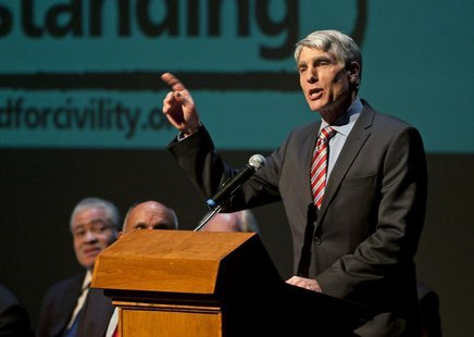 U.S. Senator Mark Udall speaks during a memorial service marking the anniversary of the Tuscon shooting, at the University of Arizona campus