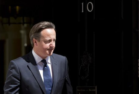 Britain's Prime Minister David Cameron waits at Downing Street to meet Columbia's President Juan Manuel Santos Calderon in London June 6, 20