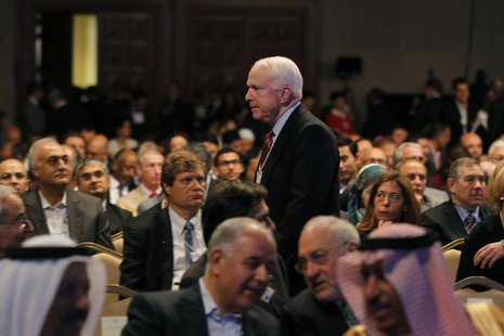U.S. Senator John McCain walks after the opening ceremony of the World Economic Forum on the Middle East and North Africa at the King Hussei