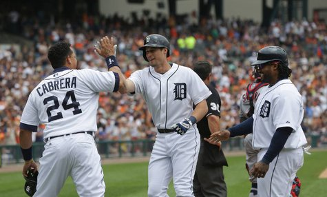Detroit Tigers OF Don Kelly (C) is congratulated by 3B Miguel Cabrera (L) and 1B Prince Fielder (R) after his three-run homer in the sixth inning enabled the Bengals to beat Cleveland, 4-1, at Comerica Park on June 9, 2013. (photo courtesy Detroit Tigers)