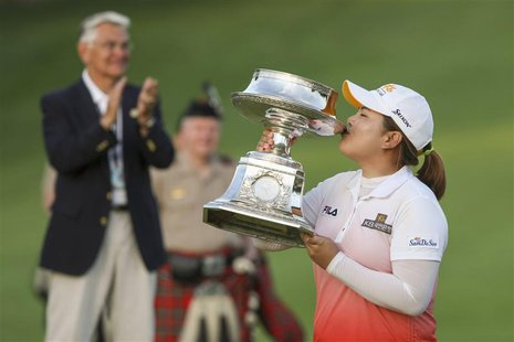 Inbee Park of South Korea kisses the trophy after winning the LPGA Golf Championship in Pittsford, New York June 9, 2013. REUTERS/Adam Fenst