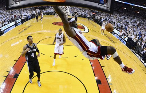 Miami Heat's LeBron James dunks on San Antonio Spurs Danny Green (4) during Game 2 of their NBA Finals basketball playoff in Miami, Florida