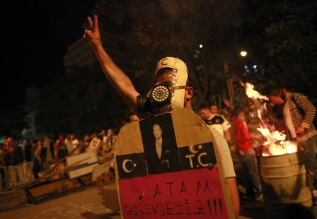 An anti-government protester gestures during a demonstration in central Ankara June 9, 2013. REUTERS/Dado Ruvic