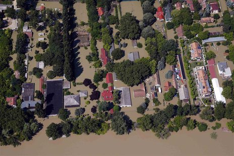 An aerial view of settlements partially submerged in flood waters from the swollen Danube River is pictured in Budapest June 9, 2013. REUTER