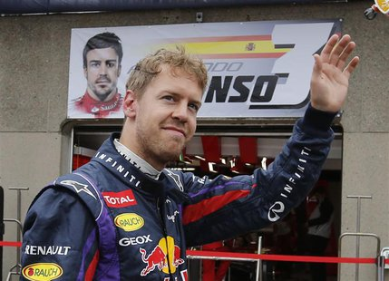 Red Bull Formula One driver Sebastian Vettel of Germany waves during the first practice session of the Canadian F1 Grand Prix at the Circuit