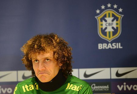 Brazil's football player David Luiz listens to questions during a news conference ahead of a friendly soccer match against Russia at Stamfor