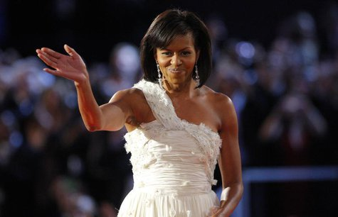 U.S. first lady Michelle Obama, dressed in Jason Wu, waves to the crowd after dancing her first dance of inauguration night with President B
