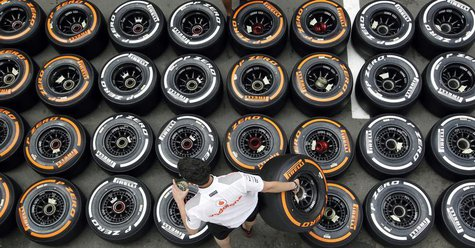 McLaren Formula One mechanic arranges Pirellis tyres in the paddock ahead of the Spanish Grand Prix at the Circuit de Catalunya in Montmelo,