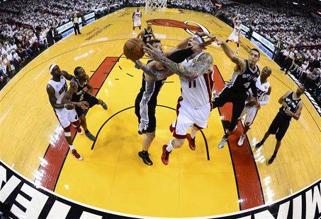 Miami Heat's Chris Andersen (11) goes to the basket against San Antonio Spurs' Tiago Splitter during Game 2 of their NBA Finals basketball p