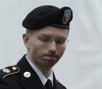 U.S. Army Private First Class Bradley Manning enters the courtroom for day four of his court martial at Fort Meade, Maryland June 10, 2013.