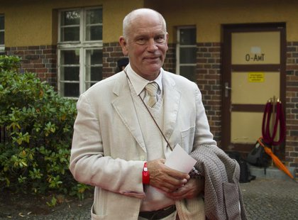 U.S. actor John Malkovich arrives for the premiere of the opera Carmen, directed by Volker Schloendorff, at the Seefestpiele (Lake Festival)