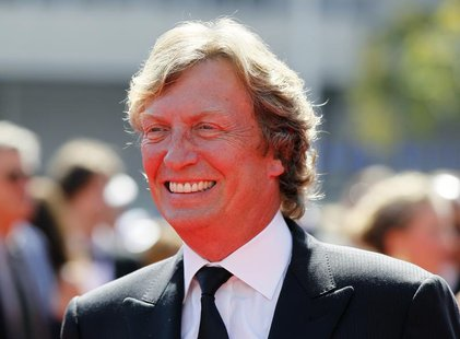 British television and film director and producer Nigel Lythgoe arrives at the 2012 Primetime Creative Arts Emmy Awards in Los Angeles Septe