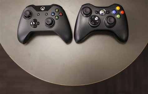 The new Xbox One controller (R), next to the previous controller during a press event unveiling Microsoft's new Xbox One in Redmond, Washing