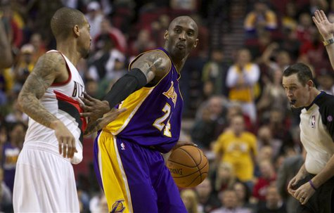 Los Angeles Lakers shooting guard Kobe Bryant (24) dribbles out the clock against the Portland Trail Blazers during second half of their NBA