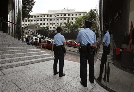 Policemen stand opposite the Consulate of the United States in Hong Kong June 10, 2013. Credit: Reuters/Bobby Yip