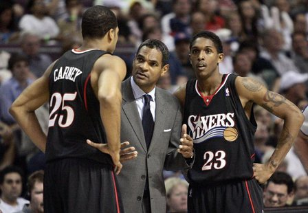 Former Philadelphia 76ers head coach Maurice Cheeks (C) talks with players Rodney Carney (L) and Louis Williams during the second half of Ga