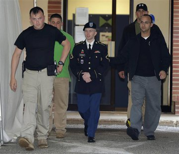 U.S. Army Private First Class Bradley Manning (C) departs the courtroom after day four of his court martial at Fort Meade, Maryland June 10,
