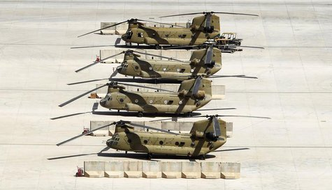 Four United States Army Chinook helicopters are parked on the tarmac at Kandahar Air Field in southern Afghanistan May 28, 2012. REUTERS/Tim