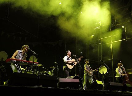 English folk rock band Mumford and Sons' Marcus Mumford (2nd L), Winston Marshall (2nd R), Ted Dwane (R) and Ben Lovett (L) perform on the m