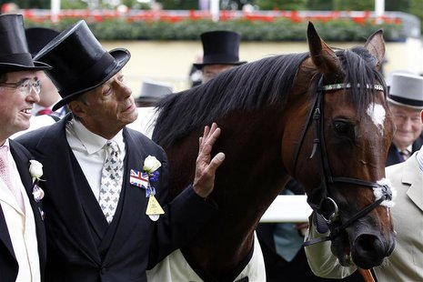 Trainer Henry Cecil poses for a photograph with the winning horse Frankel after the Queen Anne Stakes during the first day of racing at Roya