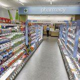 Cold and flu products are pictured on shelving during a private cocktail event celebrating the grand opening of drugstore chain Walgreens ne