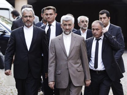 Iran's chief nuclear negotiator Saeed Jalili (C) arrives at the Iranian Consulate before his meeting with European Union foreign policy chie
