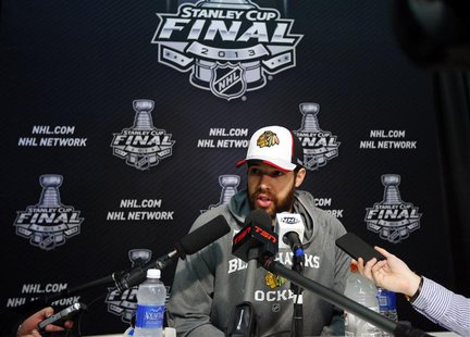 Chicago Blackhawks goalie Corey Crawford answers a question from the media during a news conference for the NHL Stanley Cup finals to be pla