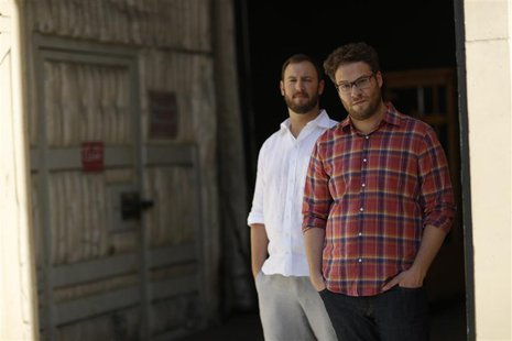 "Directors and writers Seth Rogen (R) and Evan Goldberg pose for a portrait while promoting their upcoming movie ""This Is the End"" at Sony St"