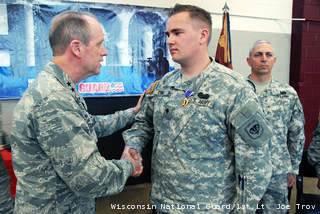 Maj. Gen. Donald Dunbar, the adjutant general of Wisconsin, awards the Purple Heart to Spc. Chase Crull, of Hollandale, Wis. (courtesy of WI National Guard).