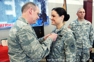 Maj. Gen. Donald Dunbar, the adjutant general of Wisconsin, awards the Purple Heart to Spc. Lindsay Peterson, of Green Bay, Wis. (courtesy of WI National Guard).