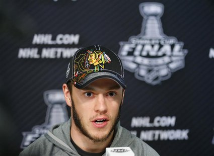 Chicago Blackhawks center Jonathan Toews answers a question from the media during a news conference for the NHL Stanley Cup finals to be pla