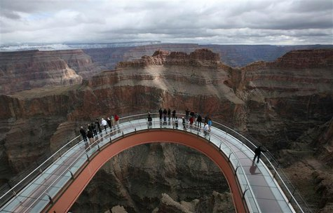 A skywalk extends out over the Grand Canyon in this view from the incomplete building that houses the skywalk, on the Hualapai Indian Reserv