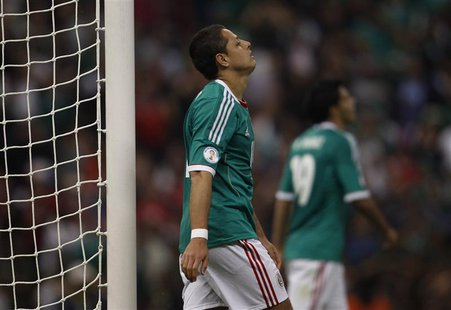 Javier Hernandez of Mexico reacts after missing a chance to score against Costa Rica during their 2014 World Cup qualifying soccer match at