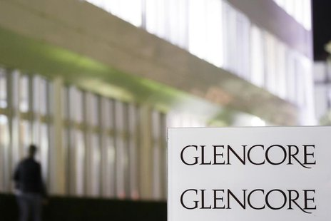 The logo of Glencore is pictured in front of the company's headquarters in the Swiss town of Baar, November 13, 2012. REUTERS/Michael Buholz